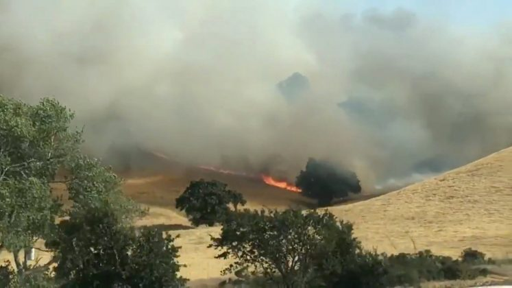 Smoke rises over a hillside on fire in Fairfield, California, the U.S., August 10, 2018, in this still image taken from a video obtained from social media. Erika Bjork/Twitter/via REUTERS