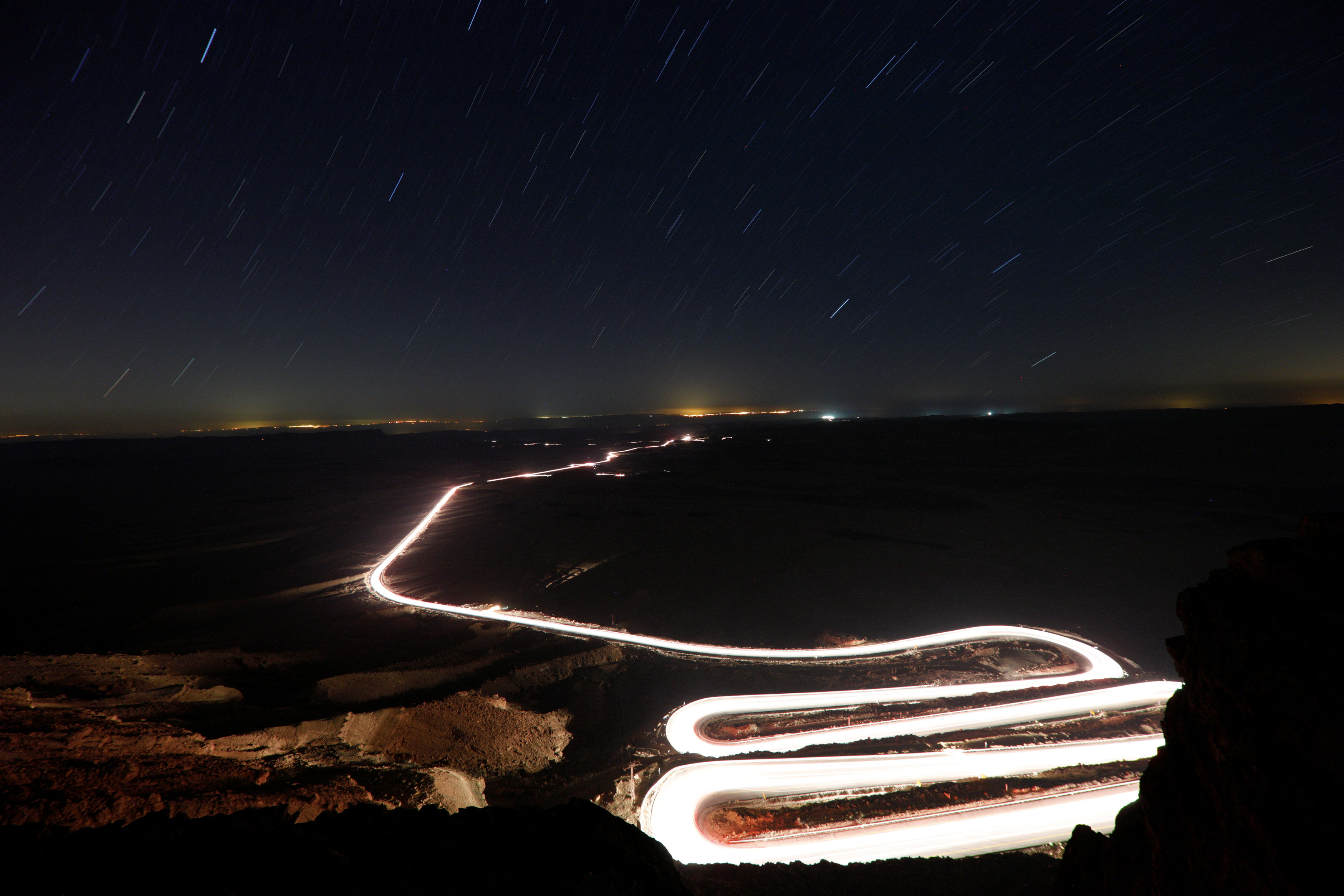 Cars drive through Ramon Crater during the Perseid meteor shower near the town of Mitzpe Ramon, southern Israel, August 12, 2018. REUTERS/Amir Cohen