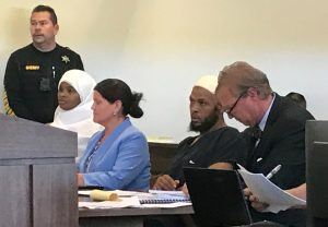Defense attorney Thomas Clark (R) sits next to his client, defendant Siraj Ibn Wahhaj, defense attorney Marie Legrand Miller (2nd L) and her client Hujrah Wahhaj (L) during a hearing on charges of child abuse in which they were granted bail in Taos County, New Mexico, U.S. August 12, 2018. REUTERS/Andrew Hay