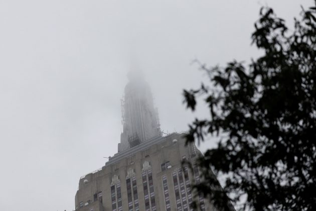 The top of the Empire State Building is covered in fog during a rainy day in Manhattan, New York, U.S., August 13, 2018. REUTERS/Shannon Stapleton
