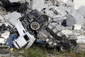 A crushed truck is seen at the collapsed Morandi Bridge site in the port city of Genoa, Italy August 14, 2018. REUTERS/Stefano Rellandini