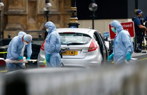 Forensic investigators work at the site after a car crashed outside the Houses of Parliament in Westminster, London, Britain, August 14, 2018. REUTERS/Henry Nicholls