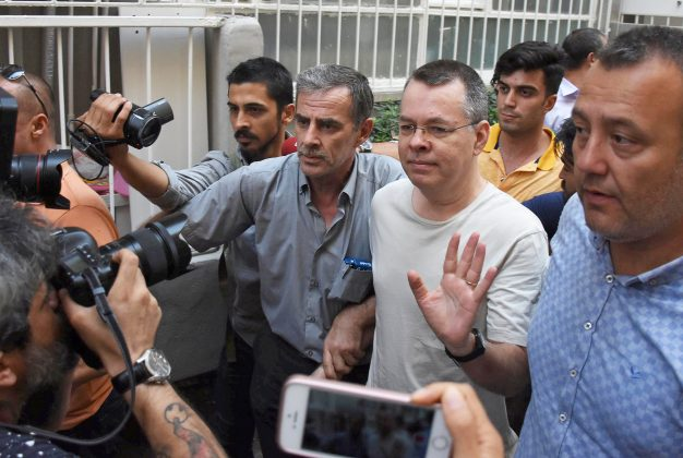 FILE PHOTO: U.S. pastor Andrew Brunson reacts as he arrives at his home after being released from the prison in Izmir, Turkey July 25, 2018. Picture taken July 25, 2018. Demiroren News Agency/DHA via REUTERS/File photo