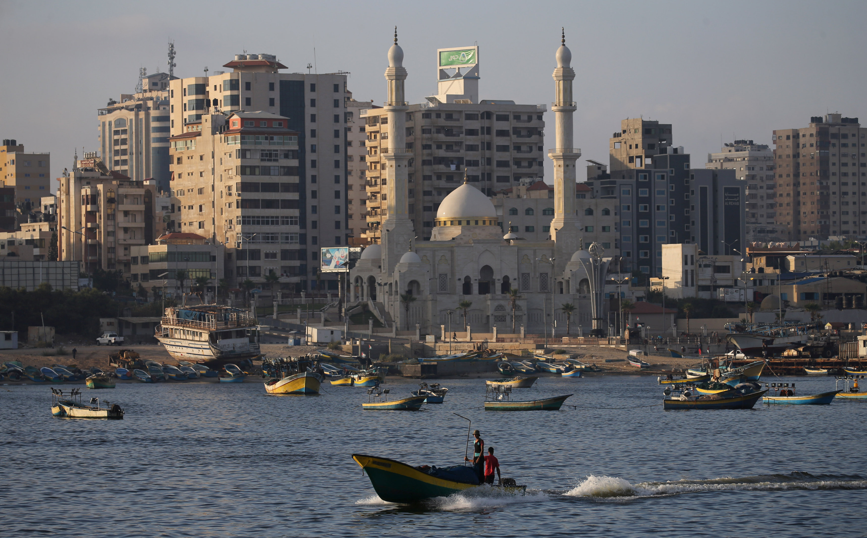 Fishing boats are seen at the seaport of Gaza City August 15, 2018. REUTERS/Ibraheem Abu Mustafa