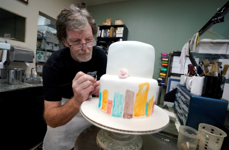 FILE PHOTO: Baker Jack Phillips decorates a cake in his Masterpiece Cakeshop in Lakewood, Colorado U.S. on September 21, 2017. REUTERS/Rick Wilking/File Photo