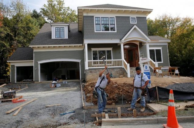 FILE PHOTO: Construction workers are pictured building a new home in Vienna, Virginia, outside of Washington, October 20, 2014./File Photo
