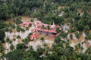 An aerial view shows partially submerged houses at a flooded area in the southern state of Kerala, India, August 17, 2018. REUTERS/Sivaram V
