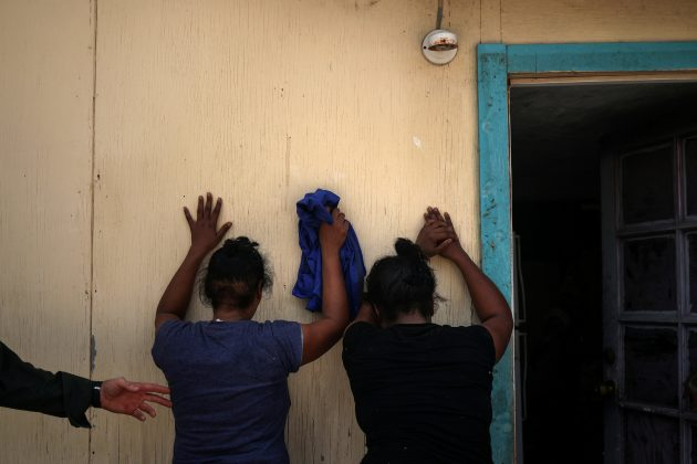 Women from the Dominican Republic are apprehended by the border patrol for illegally crossing into the U.S. border from Mexico in Los Ebanos, Texas, U.S., August 15, 2018. REUTERS/Adrees Latif