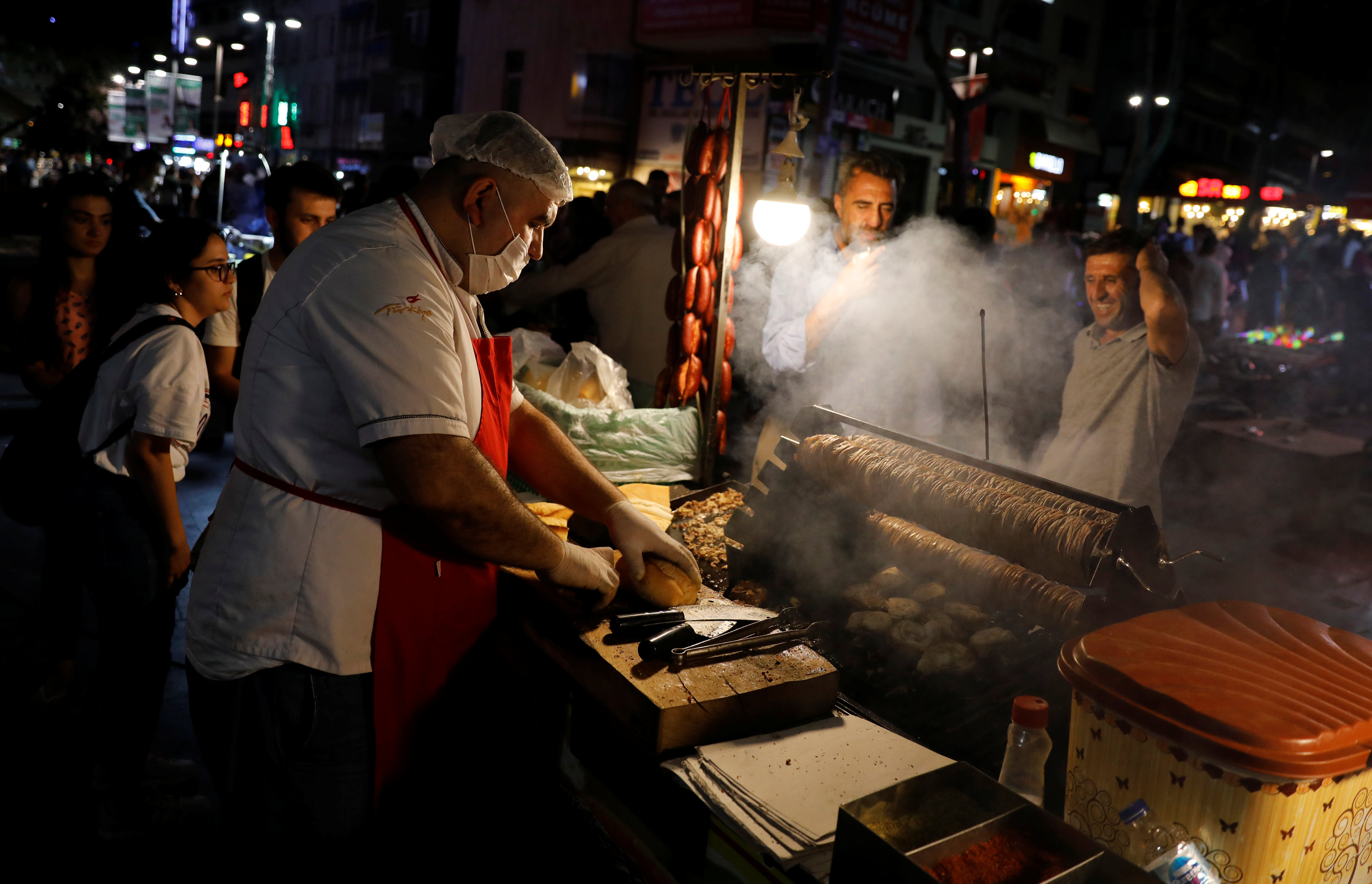 A street vendor sells food on a main street in central Ankara, Turkey August 17, 2018. REUTERS/Umit Bektas