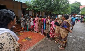 Flood-affected women wait in a queue to receive relief material at a camp in Chengannur in the southern Indian state of Kerala, India, August 20, 2018. REUTERS/Amit Dave