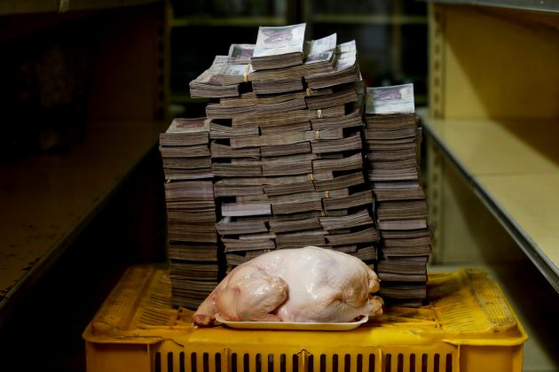 A 2.4 kg chicken is pictured next to 14,600,000 bolivars, its price and the equivalent of 2.22 USD, at a mini-market in Caracas, Venezuela. It was the going price at an informal market in the low-income neighborhood of Catia. REUTERS/Carlos Garcia Rawlins