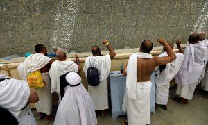 Muslim pilgrims cast stones at a pillar that symbolizes Satan, during the annual haj pilgrimage in Mena, Saudi Arabia August 21, 2018. REUTERS/Zohra Bensemra