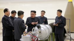 FILE PHOTO: North Korean leader Kim Jong Un provides guidance with Ri Hong Sop (3rd L) and Hong Sung Mu (L) on a nuclear weapons program in this undated photo released by North Korea's Korean Central News Agency (KCNA) in Pyongyang September 3, 2017. KCNA via REUTERS/File Photo