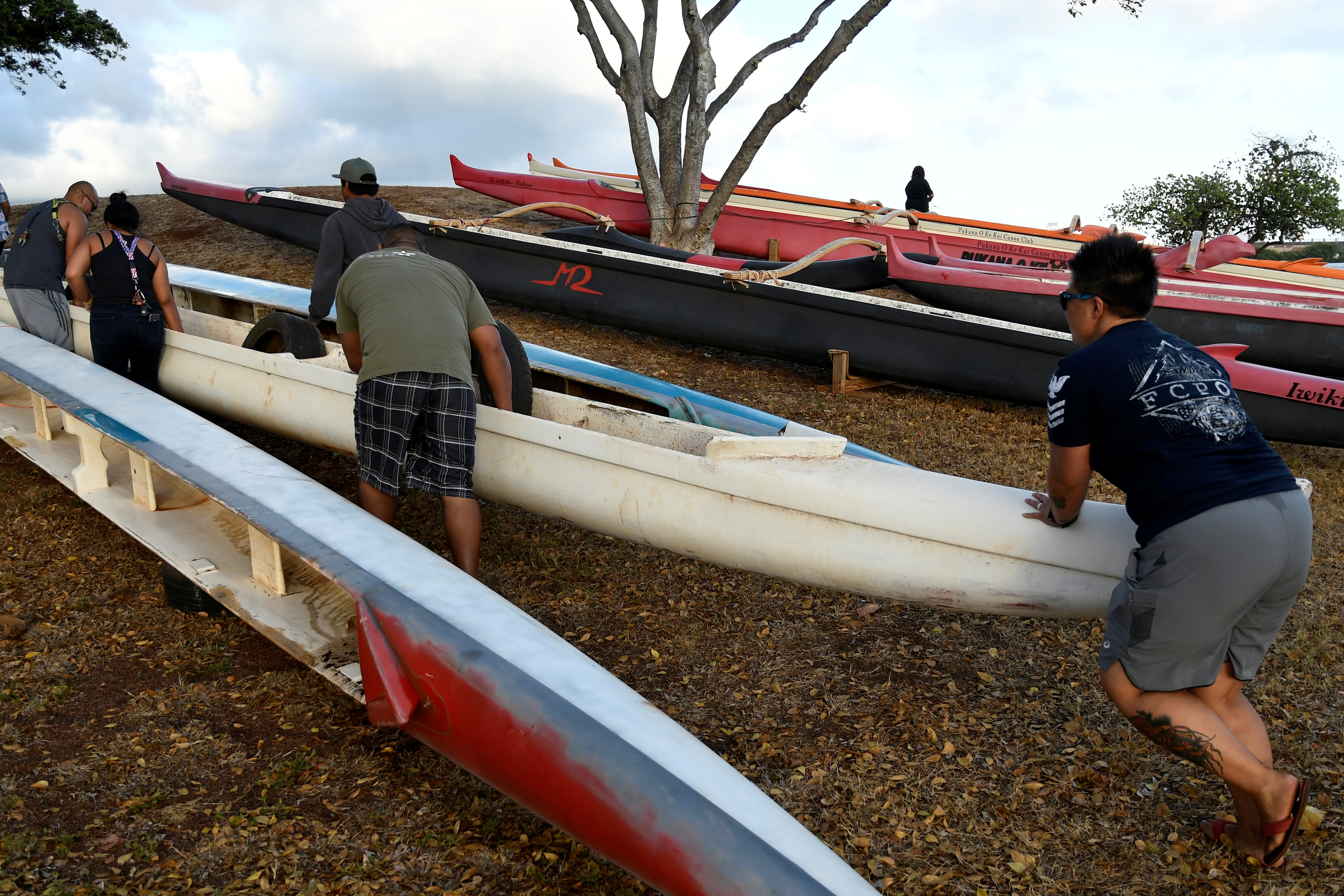 Members of the Alapahoe outrigger canoe club move their canoes off the beach to higher ground as Hurricane Lane approaches Honolulu, Hawaii, U.S. August 21, 2018. REUTERS/Hugh Gentry