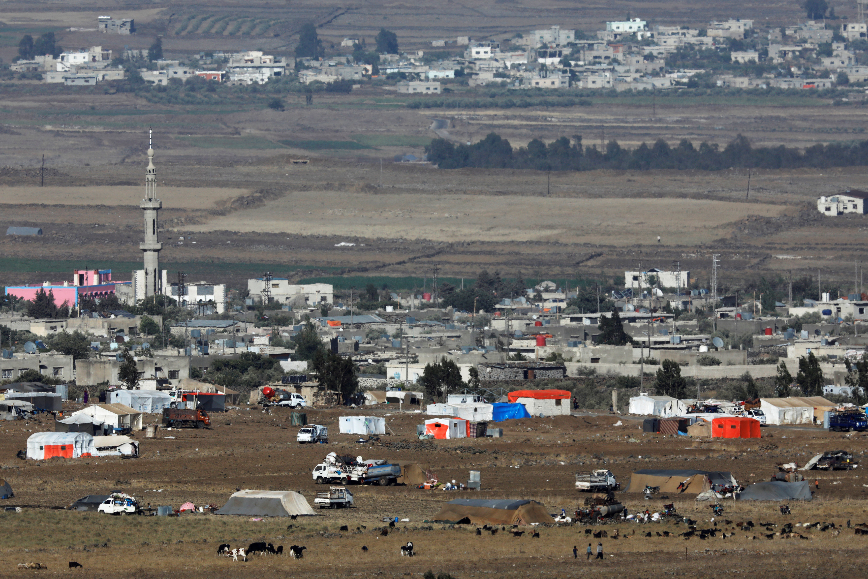 FILE PHOTO: A general view shows refugee tents erected at the Syrian side of the Israeli-Syrian border as it is seen from the Israeli-occupied Golan Heights, Israel July 19, 2018. REUTERS/Amir Cohen -/File Photo
