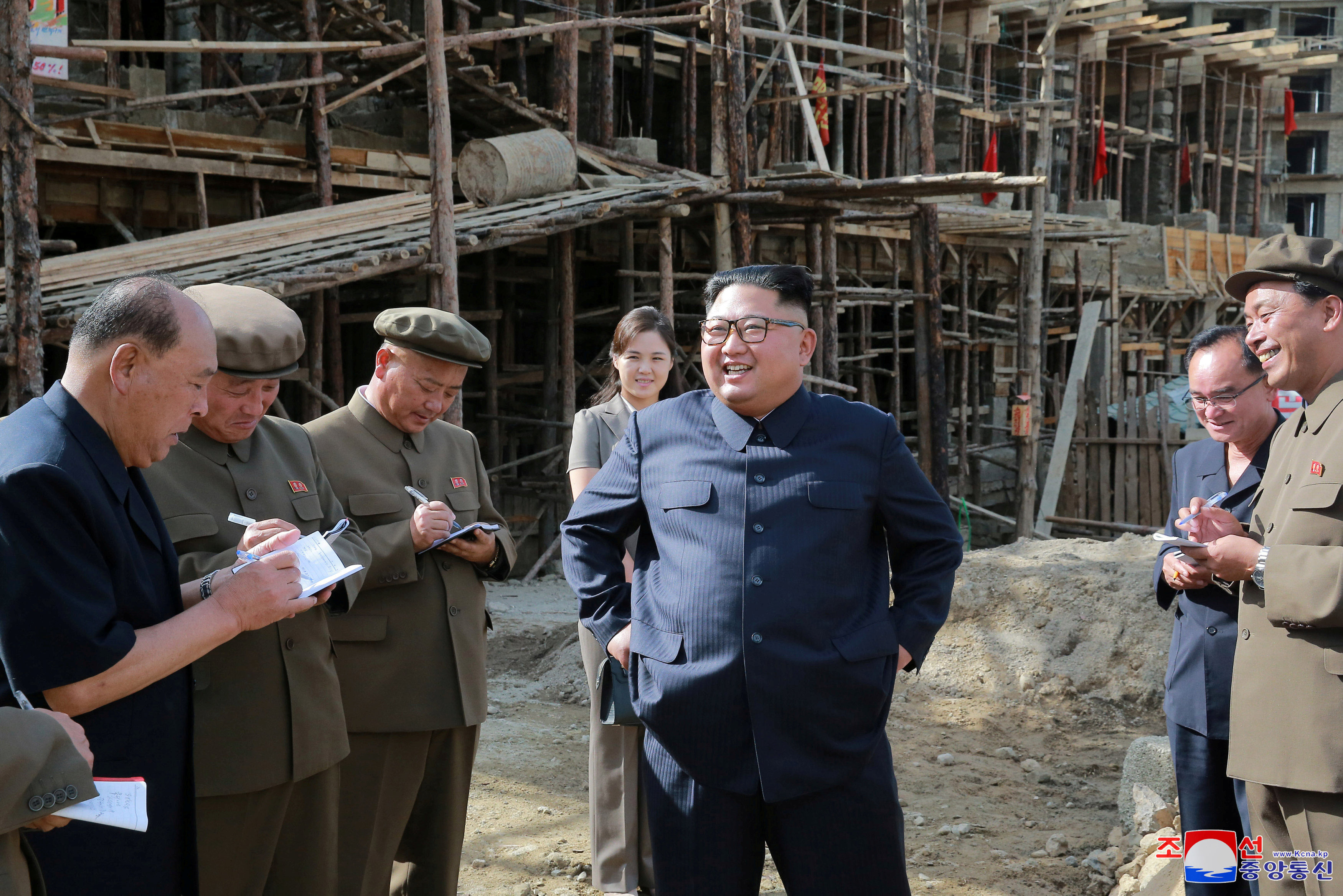 North Korean Leader Kim Jong Un and his wife Ri Sol Ju give field guidance at construction sites in Samjiyon County, North Korea, in this undated photo released by North Korea's Korean Central News Agency (KCNA) on August 18, 2018. KCNA via REUTER