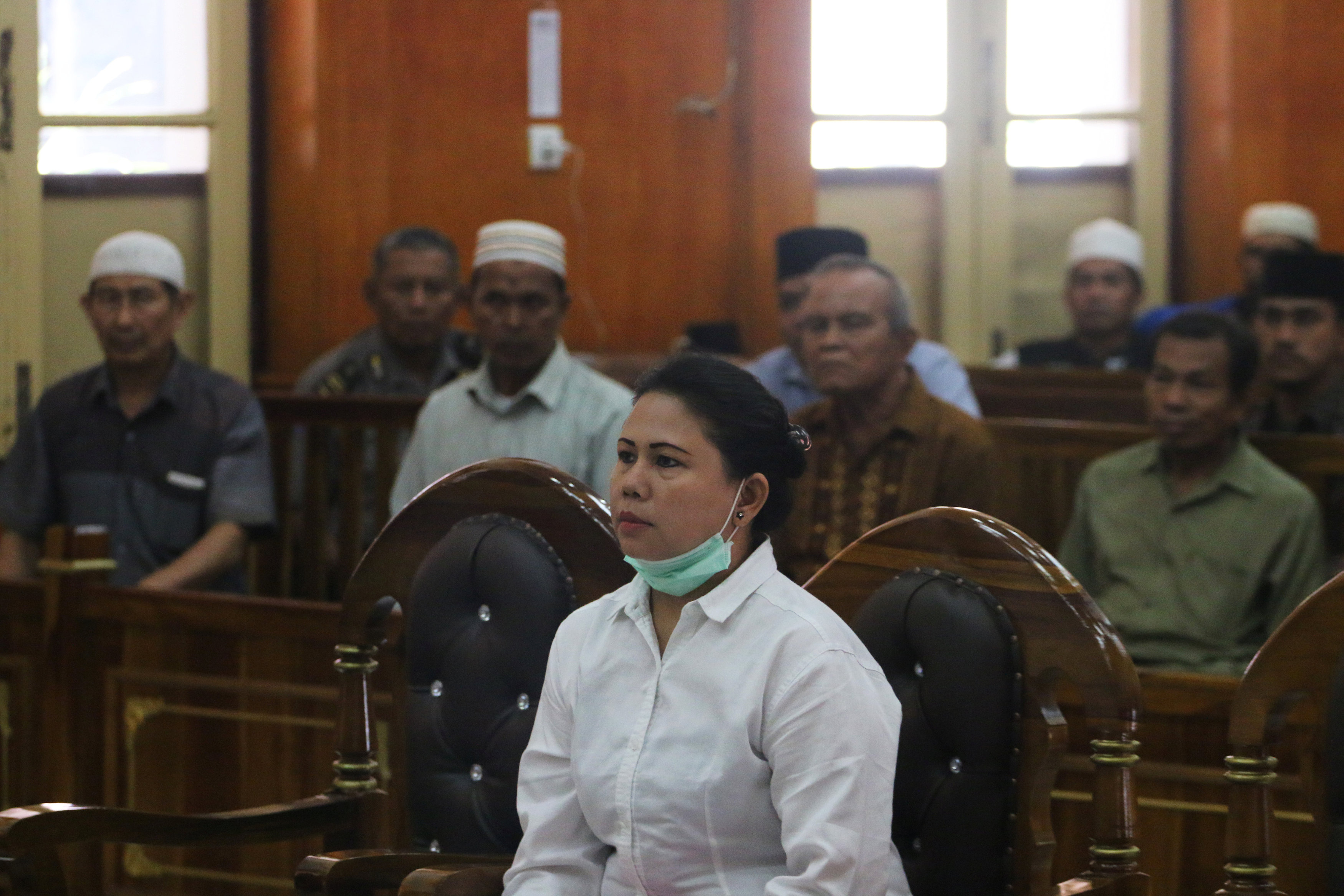 Meiliana, a 44-year-old ethnic Chinese Buddhist, sits in a courtroom for blasphemy charges, in Medan, Sumatra, Indonesia August 21, 2018, in this photo taken by Antara Foto. Picture taken August 21, 2018. Antara Foto/Irsan Mulyadi/via REUTERS