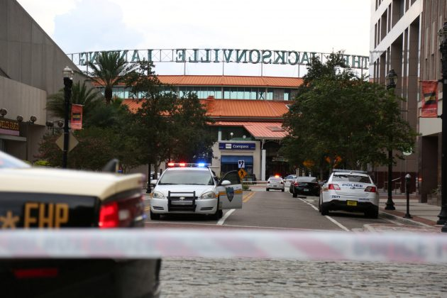 Police officers cordon off a street outside The Jacksonville Landing after a shooting during a video game tournament in Jacksonville, Florida August 26, 2018. REUTERS/Joey Roulette