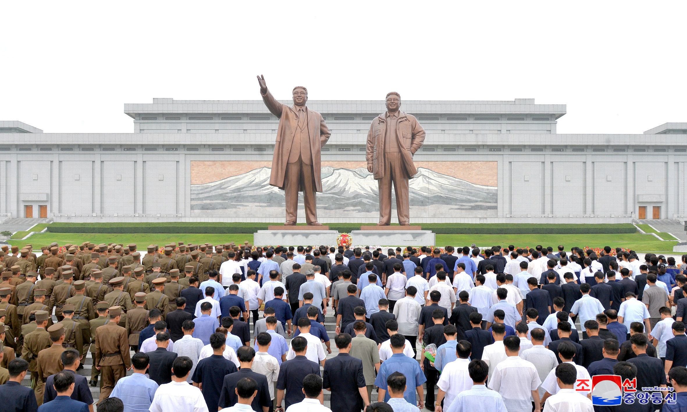 People and soldiers gather to offer flowers to the statues of state founder Kim Il Sung and former leader Kim Jong Il on the Day of Songun at Mansu hill, Pyongyang, North Korea, in this undated photo released by North Korea's Korean Central News Agency (KCNA) on August 26, 2018. KCNA via REUTERS