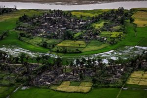 FILE PHOTO: The remains of a burned Rohingya village are seen in this aerial photograph near Maungdaw, north of Rakhine State, Myanmar September 27, 2017. REUTERS/Soe Zeya Tun/File Photo