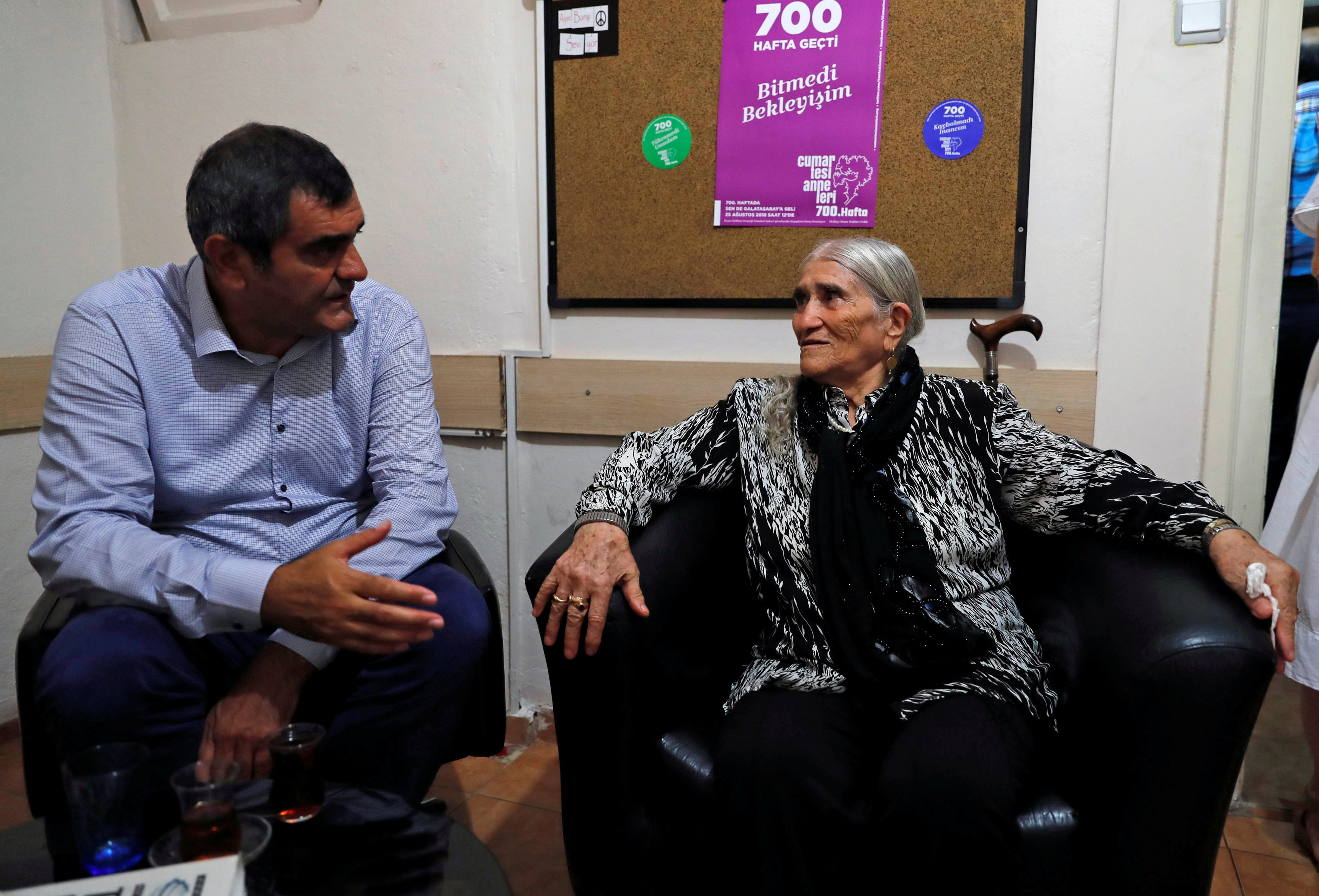 "Emine Ocak, (R) mother of Hasan Ocak who went missing in 1995 and a member of ""Saturday Mothers"", talks with her friend before an interview with Reuters in Istanbul, Turkey, August 27, 2018. Picture taken August 27, 2018. REUTERS/Osman Orsal"