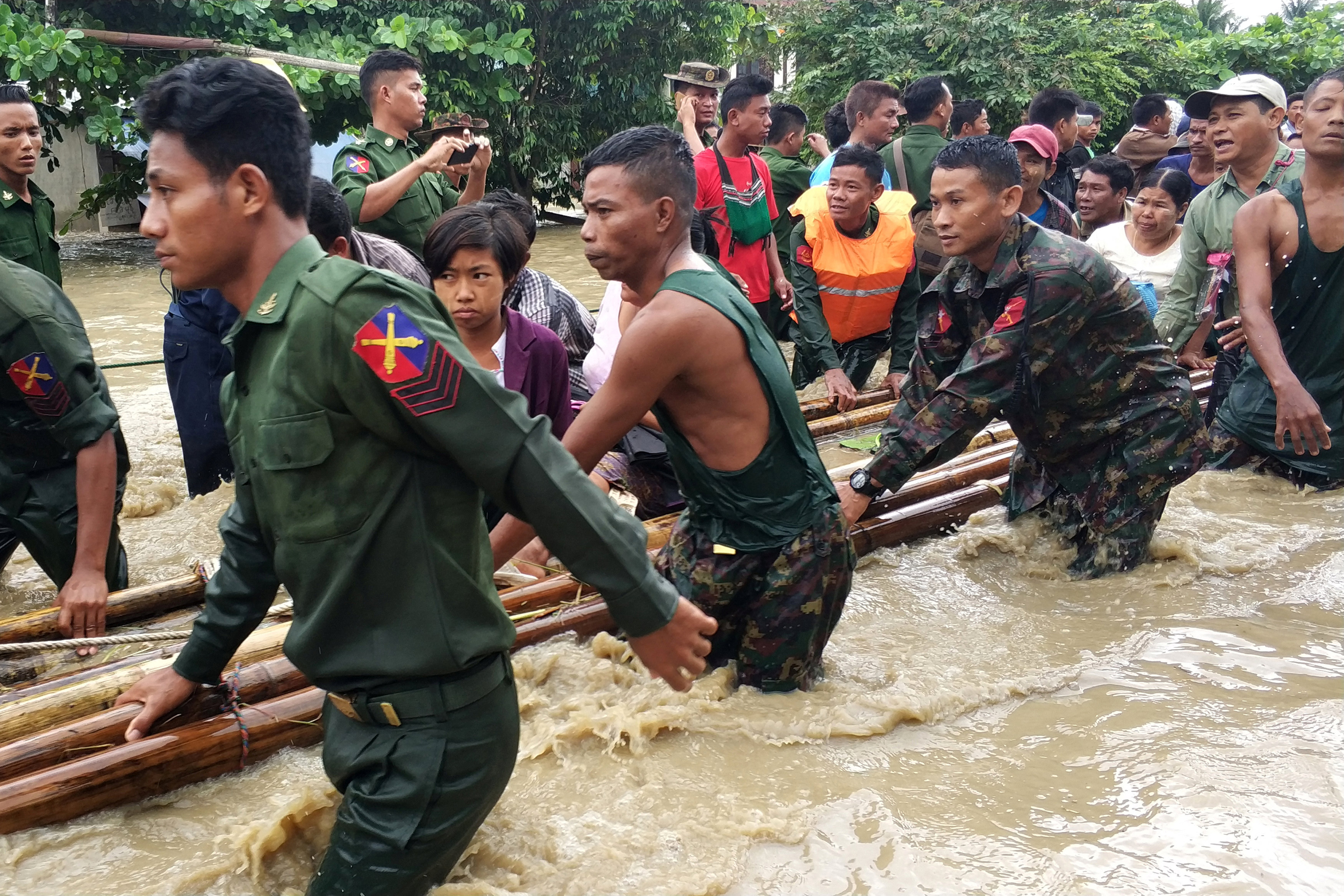 People are evacuated by Myanmar soldiers after flooding in Swar township, Myanmar August 29, 2018. REUTERS/Stringer