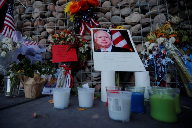A makeshift memorial stands outside the offices of the late U.S. Senator John McCain in Phoenix, Arizona, U.S., August 28, 2018. REUTERS/Brian Snyder