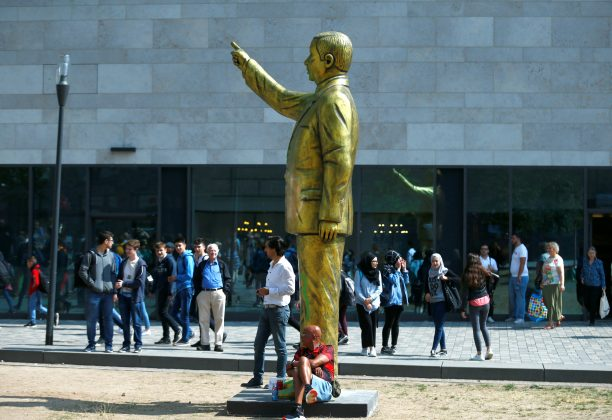 "People stand near a statue of Turkish President Tayyip Erdogan during the art exhibition ""Wiesbaden Biennale"" in Wiesbaden, Germany, August 28, 2018. REUTERS/Ralph Orlowski"