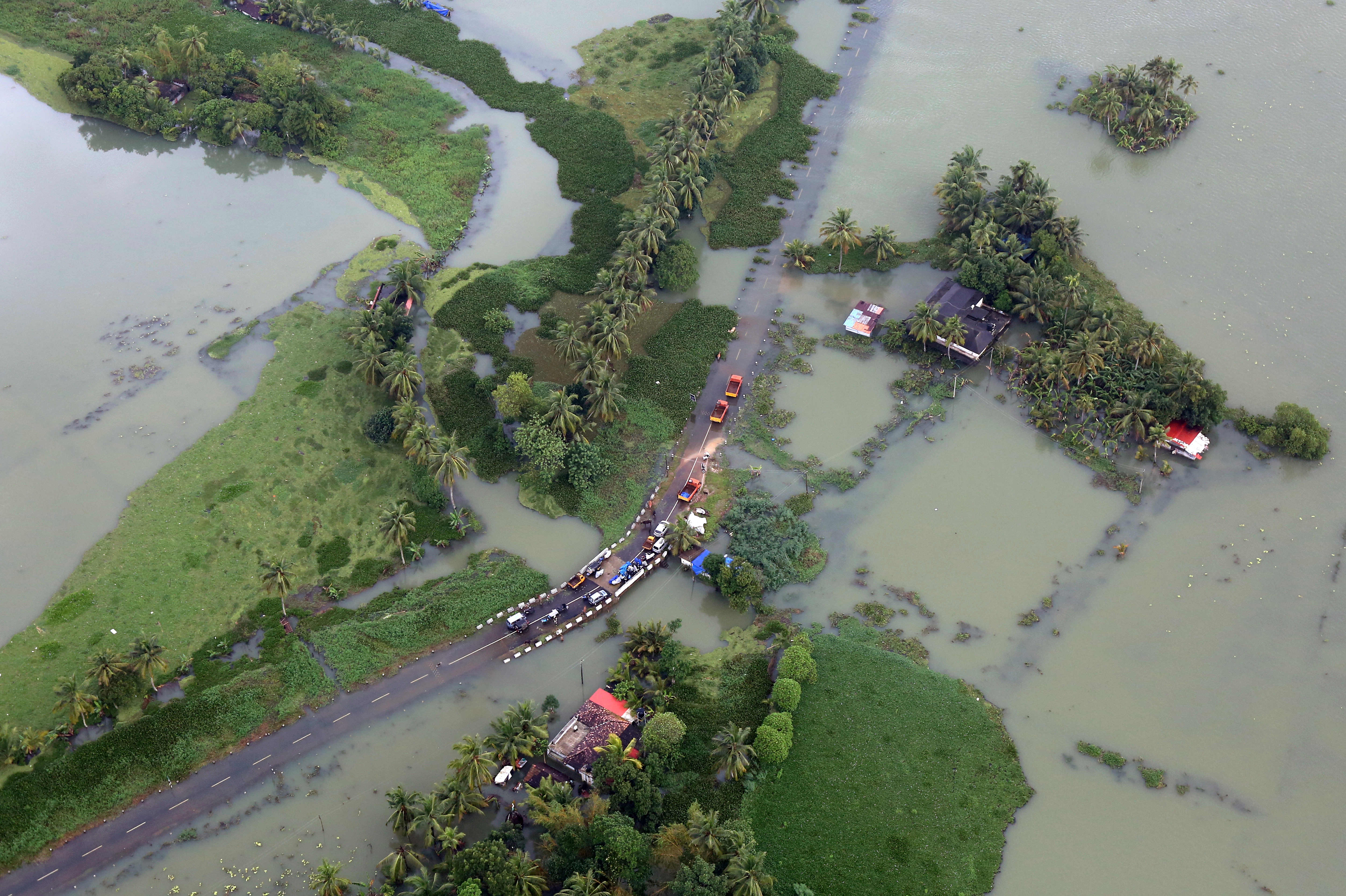 An aerial view shows a partially submerged road at a flooded area in the southern state of Kerala, India, August 19. REUTERS/Sivaram V