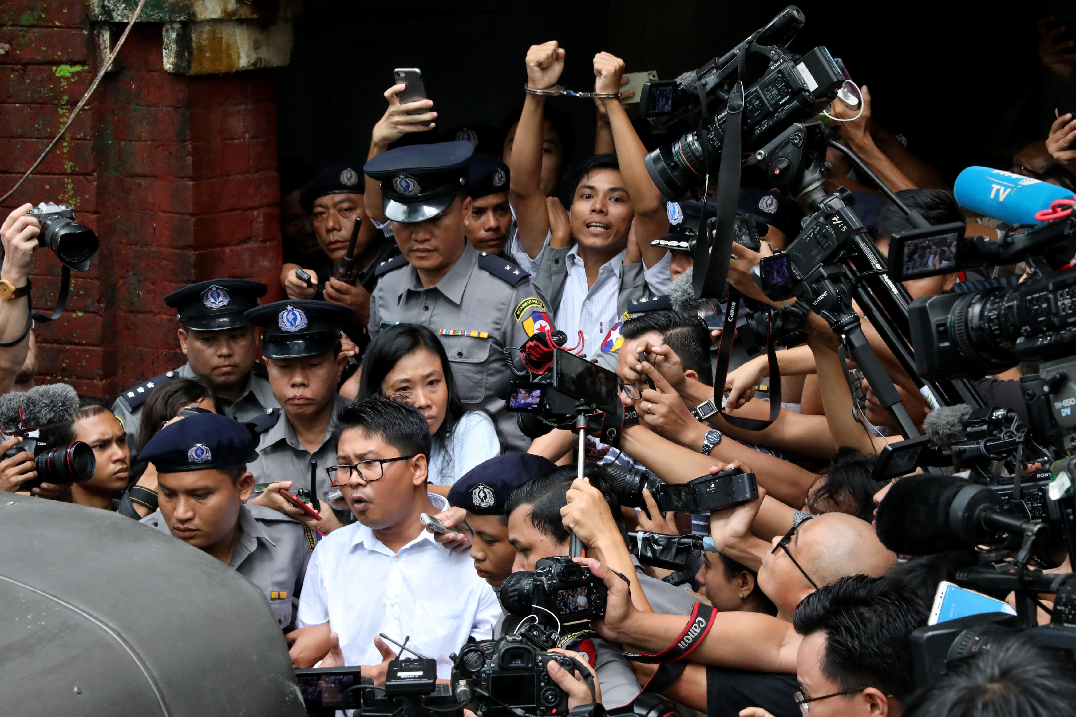 Detained Reuters journalists Wa Lone and Kyaw Soe Oo leave Insein court after listening to the verdict in Yangon, Myanmar September 3, 2018. REUTERS/Stringer