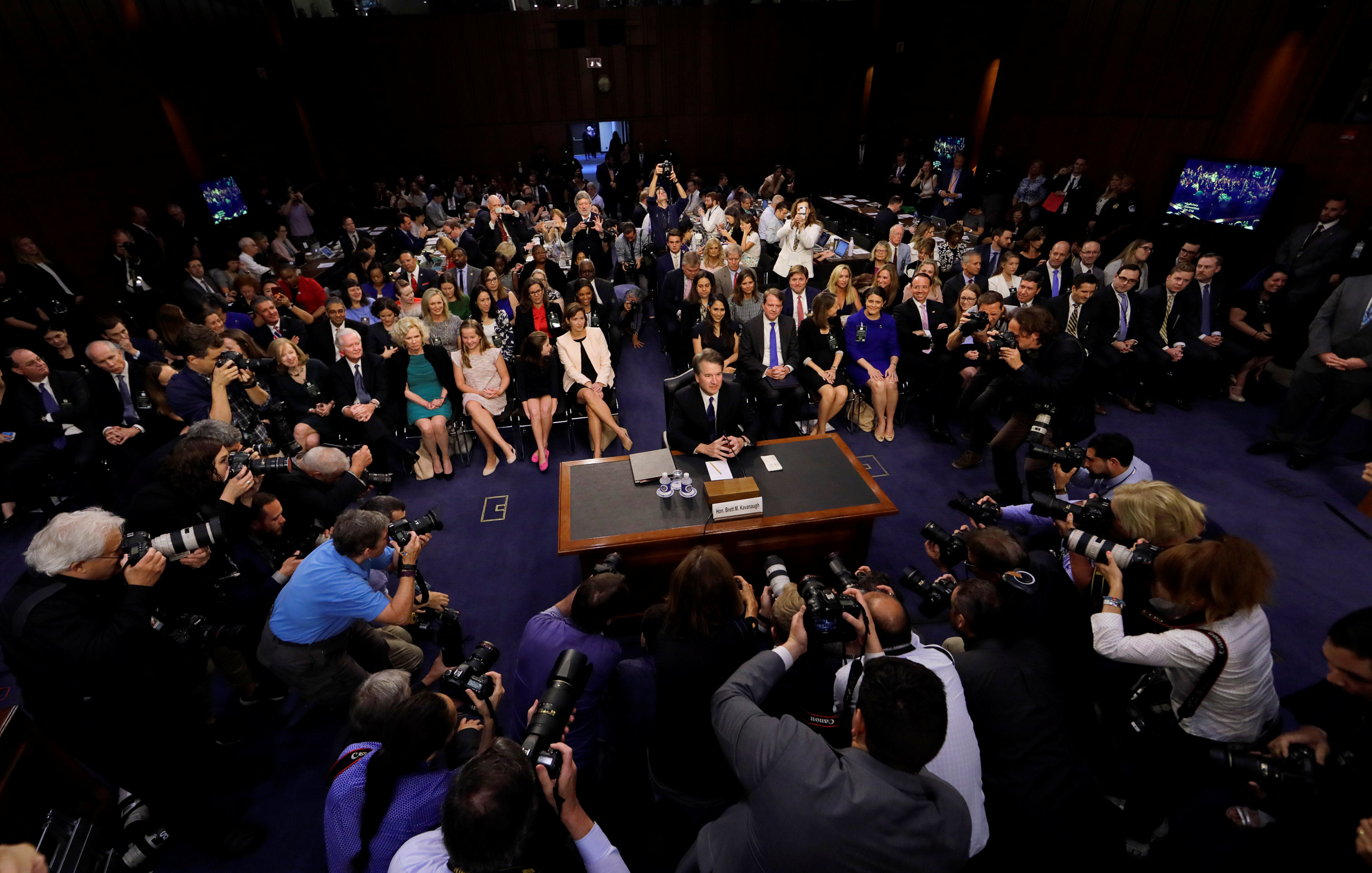 U.S. Supreme Court nominee judge Brett Kavanaugh is surrounded by photographers as he takes his seat for his Senate Judiciary Committee confirmation hearing on Capitol Hill in Washington, U.S., September 4, 2018. REUTERS/Jim Bourg