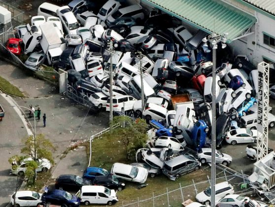 Vehicles damaged by Typhoon Jebi are seen in Kobe, western Japan, in this photo taken by Kyodo September 5, 2018. Kyodo/via REUTERS