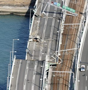 A bridge connecting Kansai airport, damaged by crashing with a 2,591-tonne tanker, which is sent by strong wind caused by Typhoon Jebi, is seen in Izumisano, western Japan, in this photo taken by Kyodo September 5, 2018. Kyodo/via REUTERS