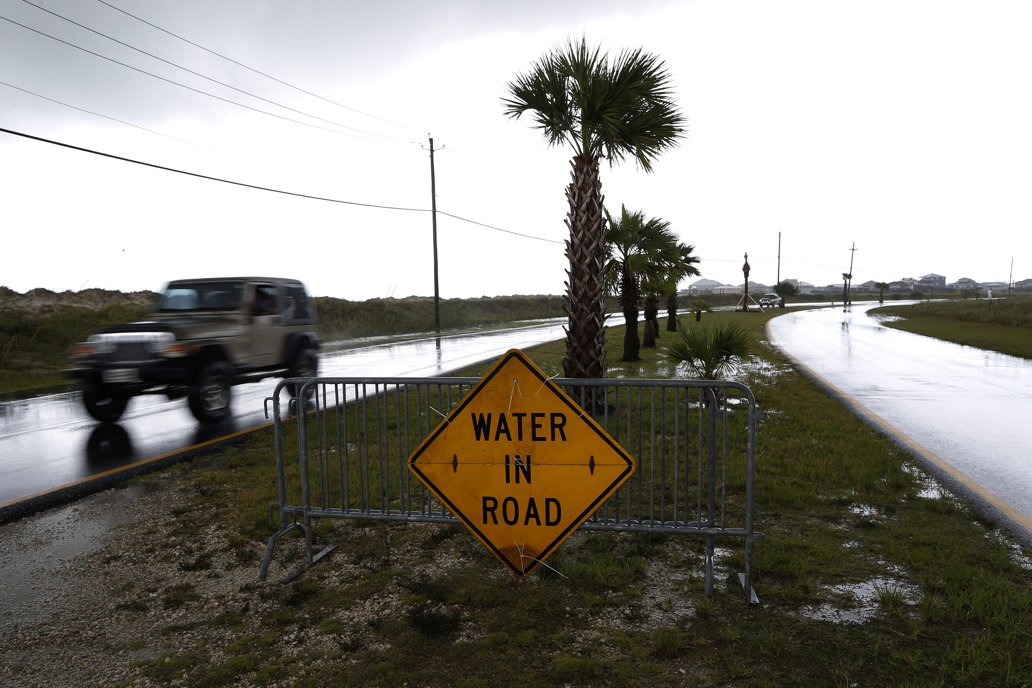 A car passes a sign after Tropical Storm Gordon in Dauphin Island, Alabama, U.S., September 5, 2018. REUTERS/Jonathan Bachman