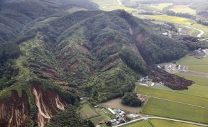 Landslides caused by an earthquake are seen in Atsuma town in Japan's northern island of Hokkaido, Japan, in this photo taken by Kyodo September 6, 2018. Kyodo/via REUTERS