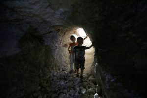 Children walk in a makeshift shelter in an underground cave in Idlib, Syria September 3, 2018. REUTERS/Khalil Ashawi