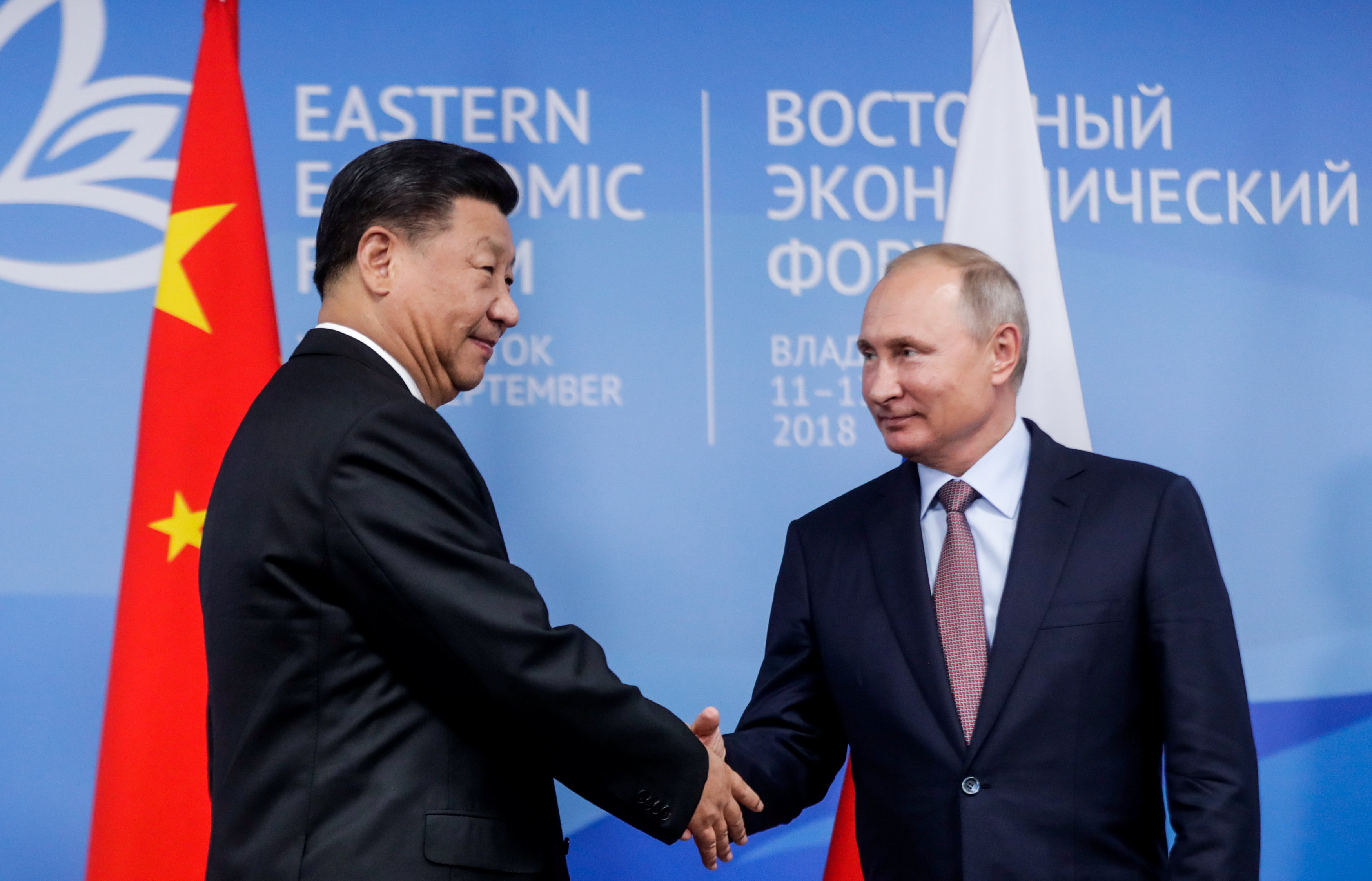 Russian President Vladimir Putin shakes hands with Chinese President Xi Jinping during their meeting on the sidelines of the Eastern Economic Forum in Vladivostok, Russia September 11, 2018. Mikhail Metzel/TASS Host Photo Agency/Pool via REUTERS
