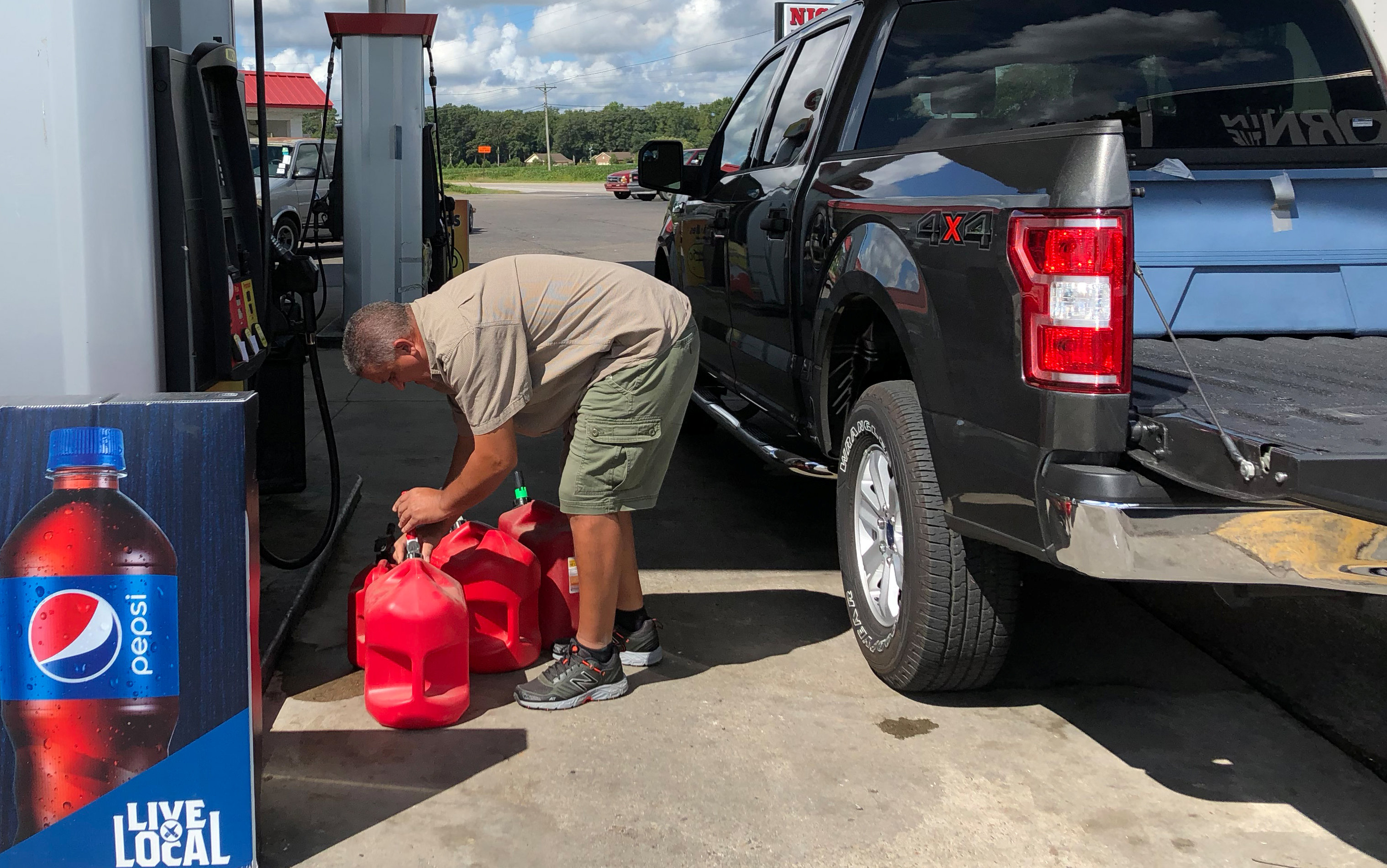 Trent Bullard fills gas containers for his generator ahead of Hurricane Florence in Pembroke, North Carolina, U.S., September 11, 2018. REUTERS/Anna Driver