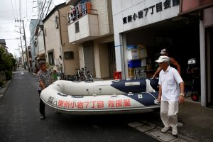 FILE PHOTO: Residents of Tokyo's Katsushika ward show a floating boat which they keep for a possible flood in Tokyo, Japan August 24, 2018. REUTERS/Kim Kyung-Hoon