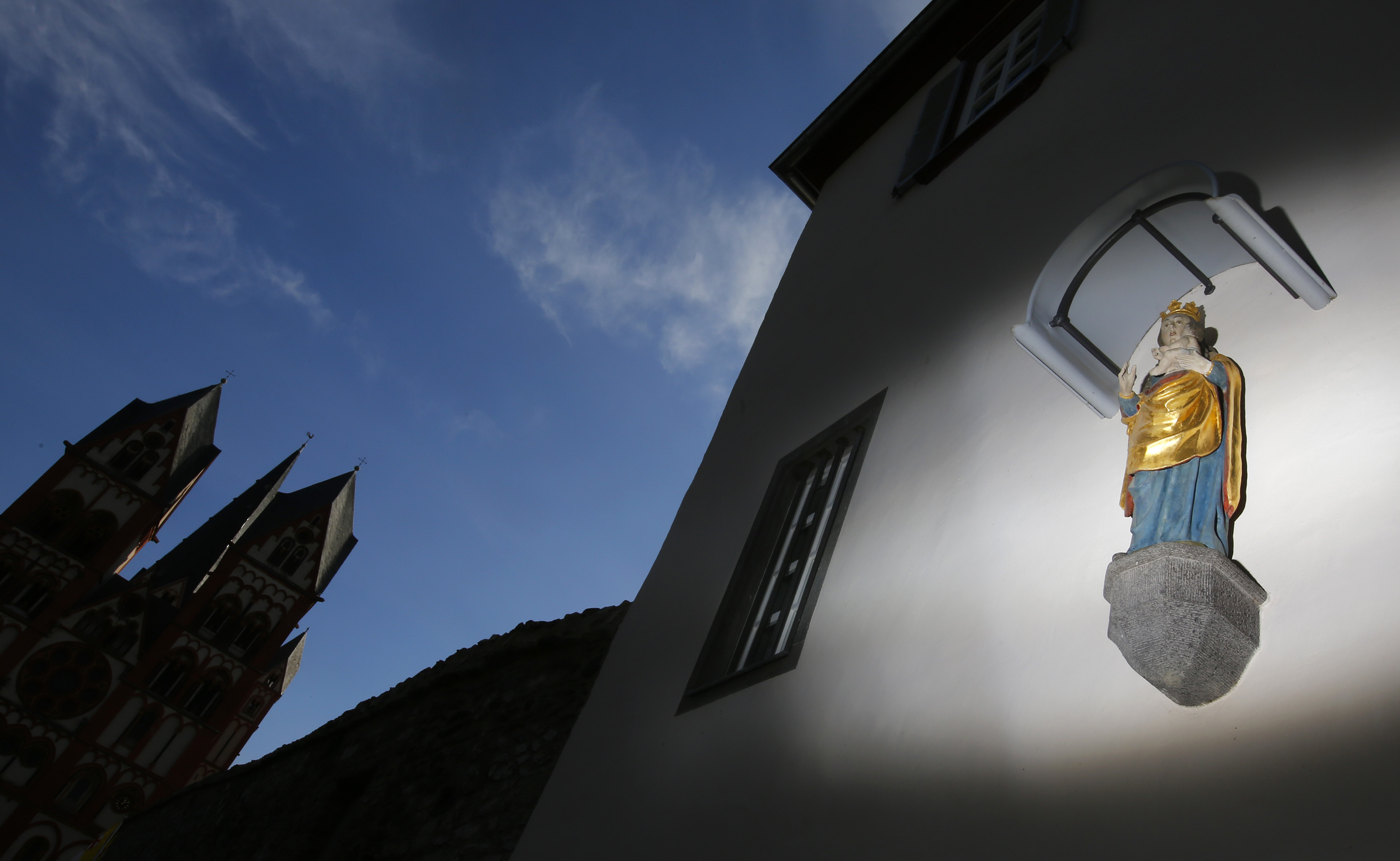 FILE PHOTO - A statue of the Virgin Mary adorns the facade of the bishop's residence next to Limburg Cathedral October 14, 2013. REUTERS/Kai Pfaffenbach