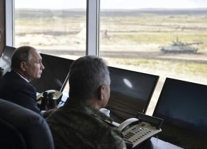 Russia's President Vladimir Putin (L) and Defence Minister Sergei Shoigu oversee the Vostok-2018 (East-2018) military drills at Tsugol firing range in Zabaikalsky Region, Russia September 13, 2018. Sputnik/Alexei Nikolsky/Kremlin via REUTERS