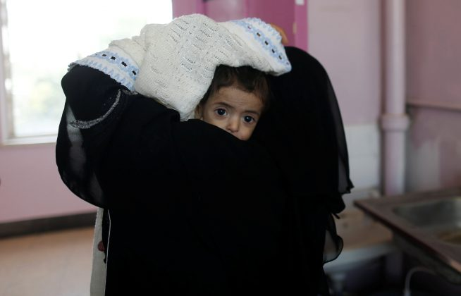 A woman carries a child at the malnutrition ward of al-Sabeen hospital in Sanaa, Yemen September 11, 2018. REUTERS/Khaled Abdullah