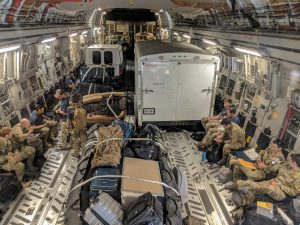 Pararescue personnel from the Alaska Air National Guard's 212th Rescue Squadron, 176th Wing, and California ANG's 131st Rescue Squadron, 129th Rescue Wing, settle into a C-17 Globemaster III aircraft in preparation for offering support to Hurricane Florence relief operations, at Moffett Federal Airfield, California, in this September 12, 2018 handout photo. Staff Sgt. Balinda O'Neal Dresel/U.S. Army National Guard/Handout via REUTERS