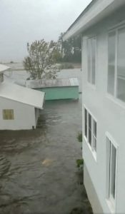 Flood waters are seen in Belhaven, North Carolina, U.S., September 14, 2018 in this still image from video obtained from social media. Courtesy of Ben Johnson/via REUTERS