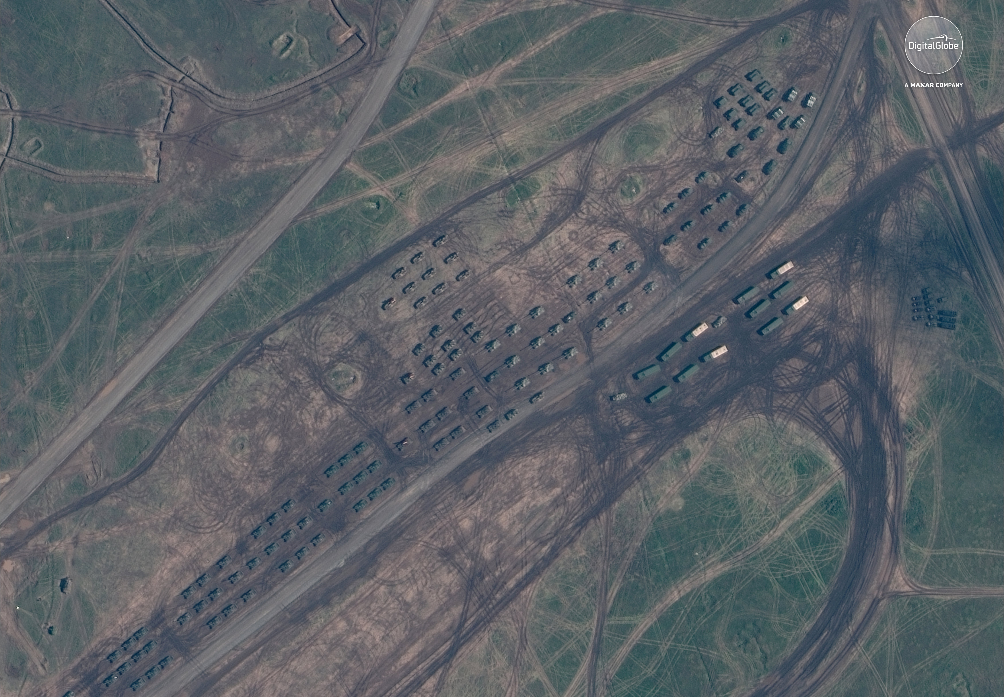 A satellite image of armored vehicles staging during the Russian military exercise known as Vostok 2018, conducted at the Tsugol training area in eastern Russia, September 13, 2018. Satellite image ©2018 DigitalGlobe, a Maxar company/Handout via REUTERS