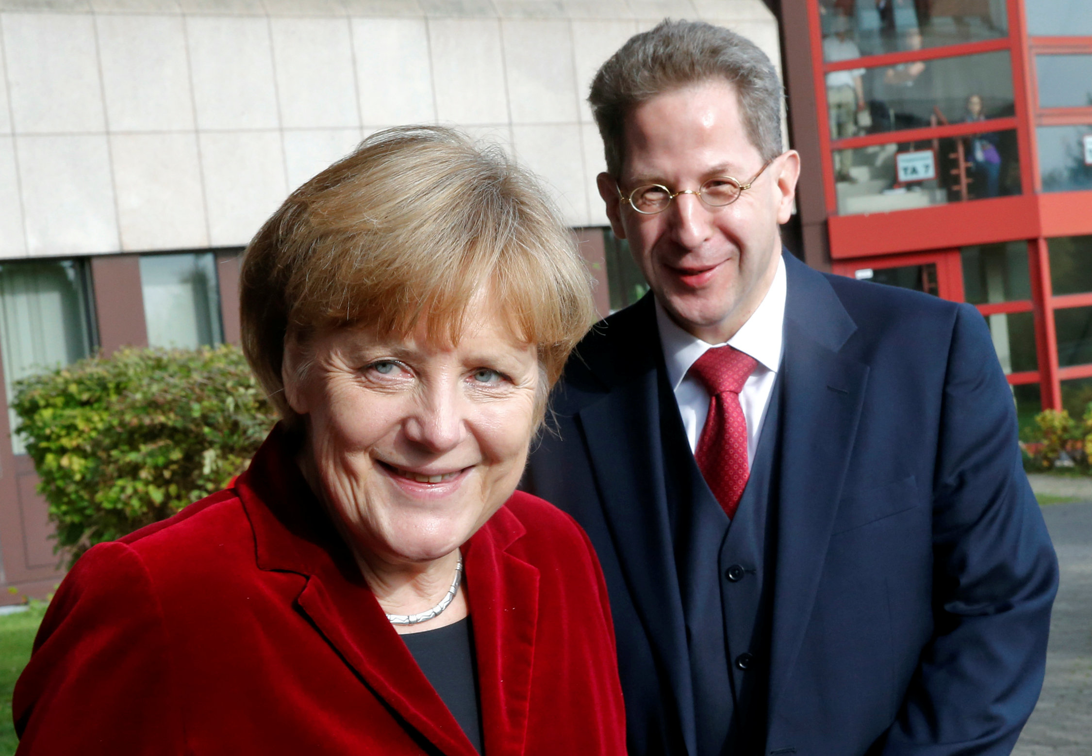 FILE PHOTO: German Chancellor Angela Merkel and Hans-Georg Maassen, the President of the Federal Office for the Protection of the Constitution, Germany's domestic security agency in Cologne, Germany October 31, 2014. REUTERS/Wolfgang Rattay/File Photo
