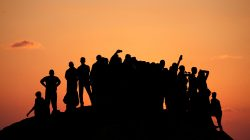 Palestinian demonstrators gather atop a hill during a protest calling for lifting the Israeli blockade on Gaza, near the maritime border with Israel, in the northern Gaza Strip September 17, 2018. REUTERS/Mohammed Salem