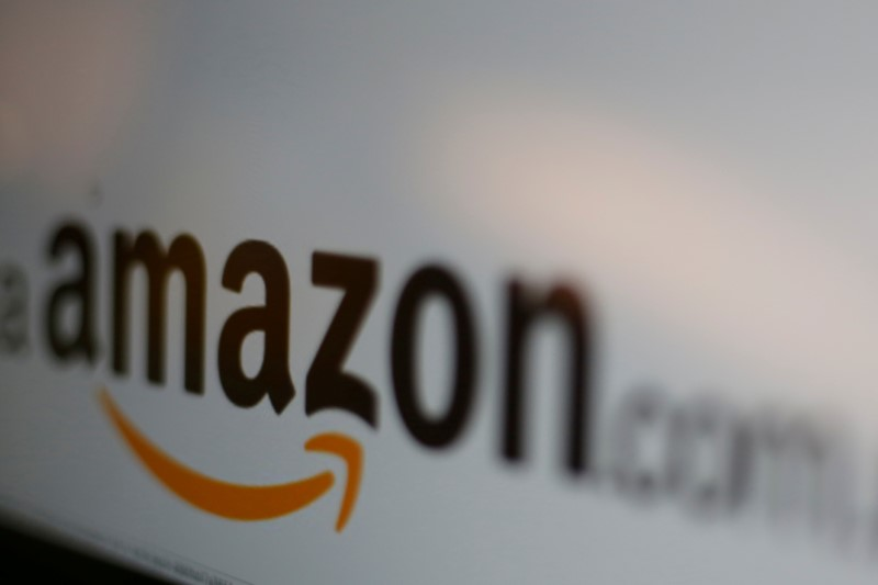 FILE PHOTO: The logo of the web service Amazon is pictured in this June 8, 2017 illustration photo. REUTERS/Carlos Jasso/Illustration/File Photo