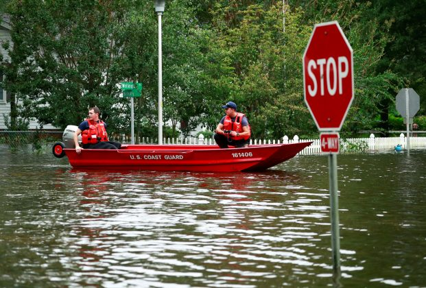 Members of the Coast Guard launch rescue boats into the neighborhood of Mayfair in the flood waters caused by Hurricane Florence in Lumberton, North Carolina, U.S. September 16, 2018. REUTERS/Jason Miczek