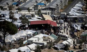 FILE PHOTO: Refugees and migrants line up for food distribution at the Moria migrant camp on the island of Lesbos, Greece October 6, 2016. REUTERS/Alkis Konstantinidis/File Photo